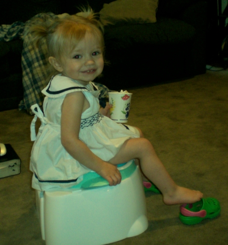 Chillin' on the potty with her popcorn