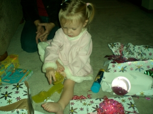 She opened two presents before she got to the ones with the shoes...