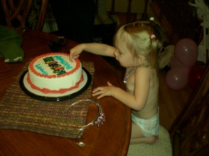 Then she got into her birthday suit and had some ice cream cake